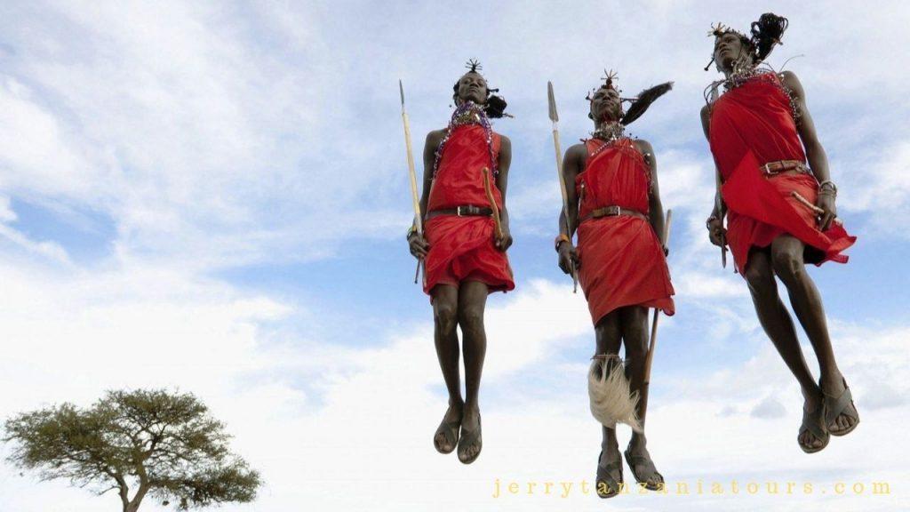 Maasai Tribe Facts: three maasai men performing adumu